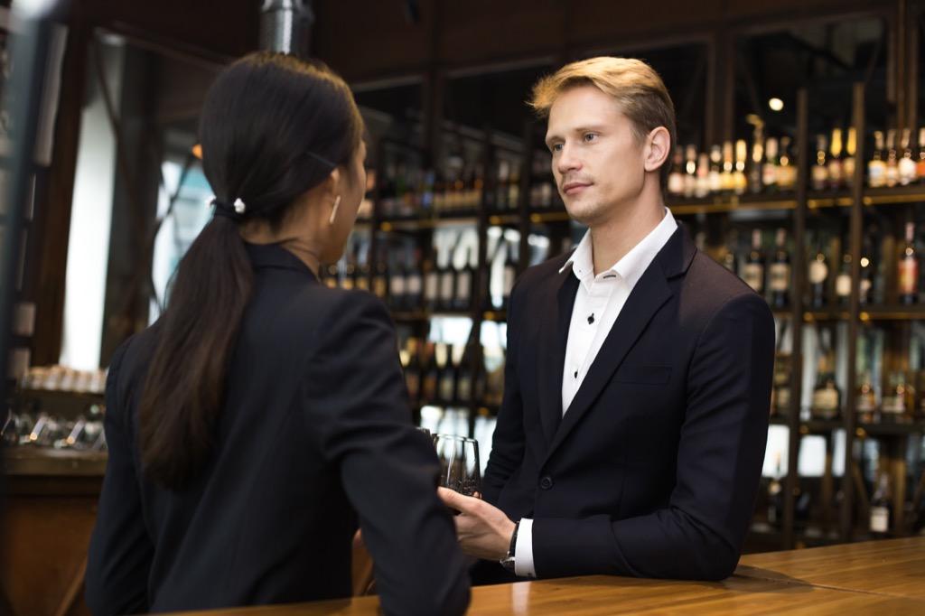 Woman Talking with Boss at Bar