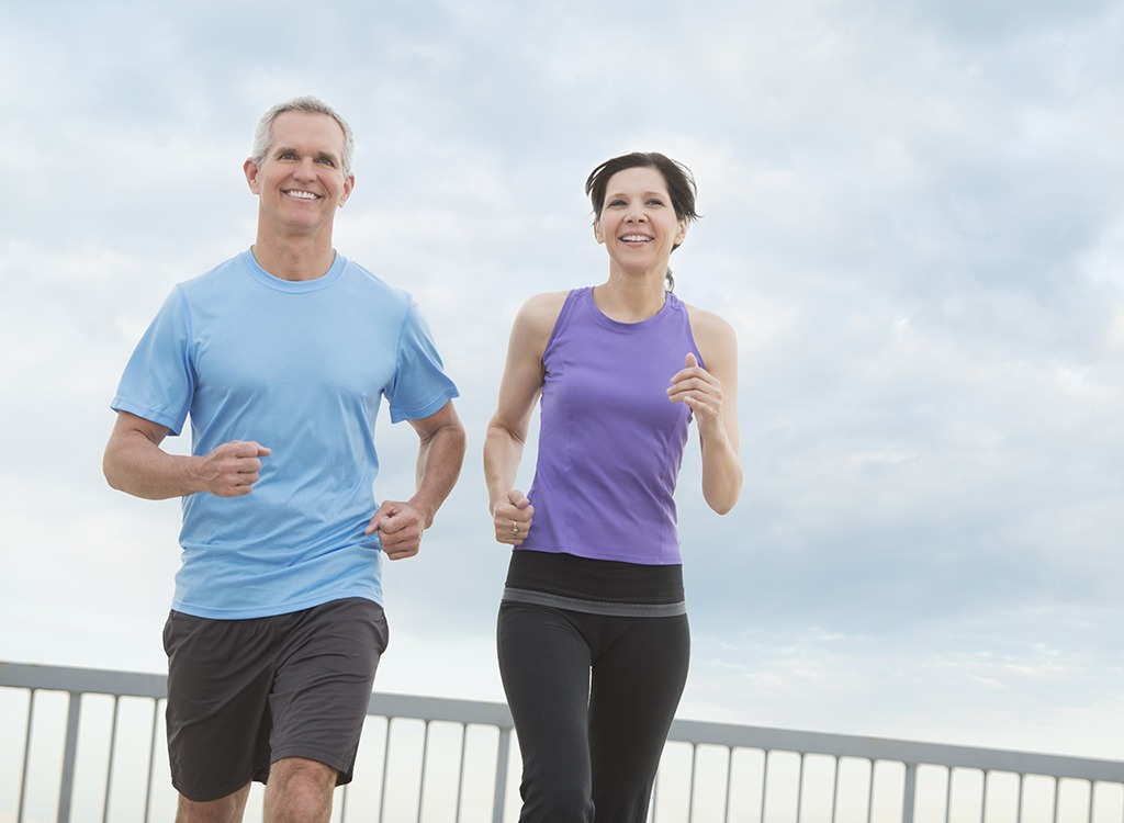 40-something couple running, healthy sex after 40