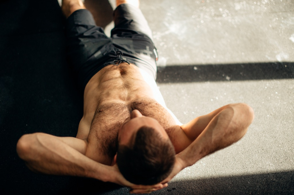 Man doing crunches Health booster