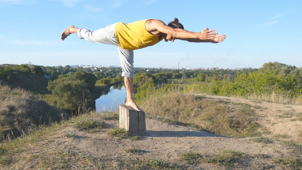 Man Working Out Doing Yoga habits linked to a longer life