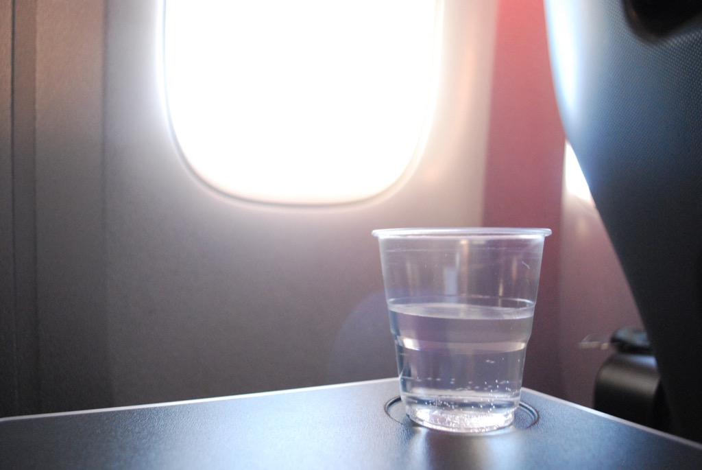 drinking water on airplane business travel