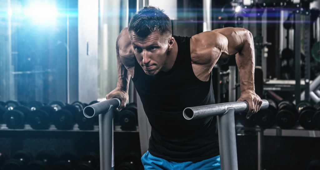 man dips gym exercise build muscle