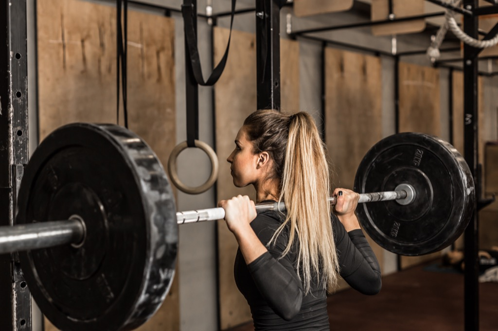 build muscle fast woman squatting