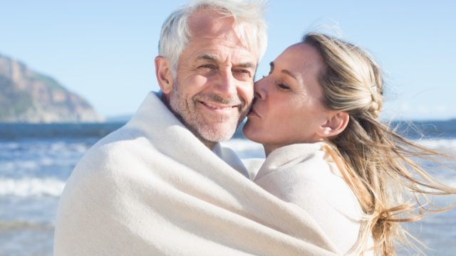 older woman kissing husband, better wife over 40