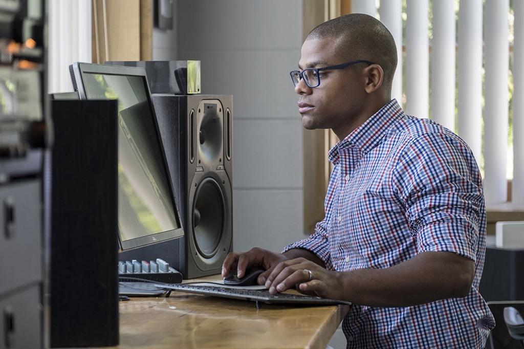 man at standing desk Smartest Men Get Ahead