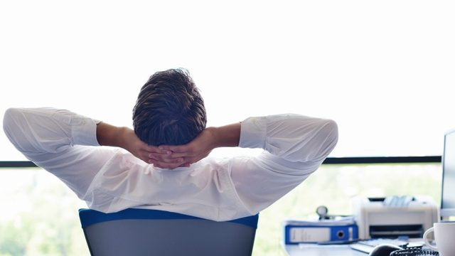 man relaxing in office chair Smartest Men Get Ahead {priorities after 50}