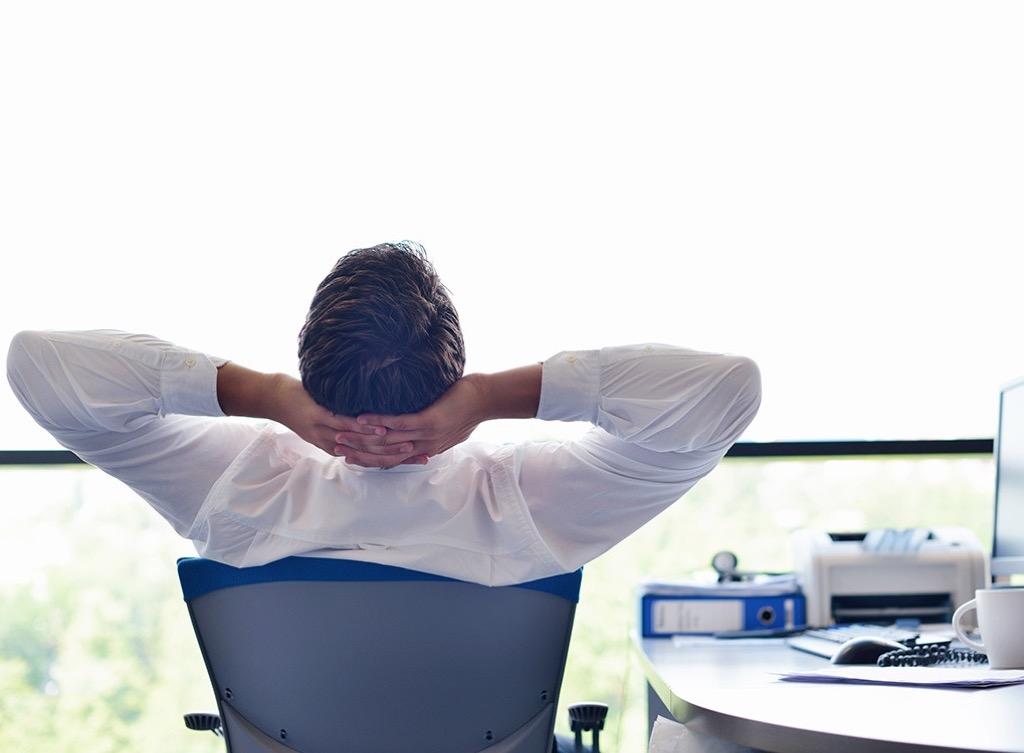 man relaxing in office chair Smartest Men Get Ahead