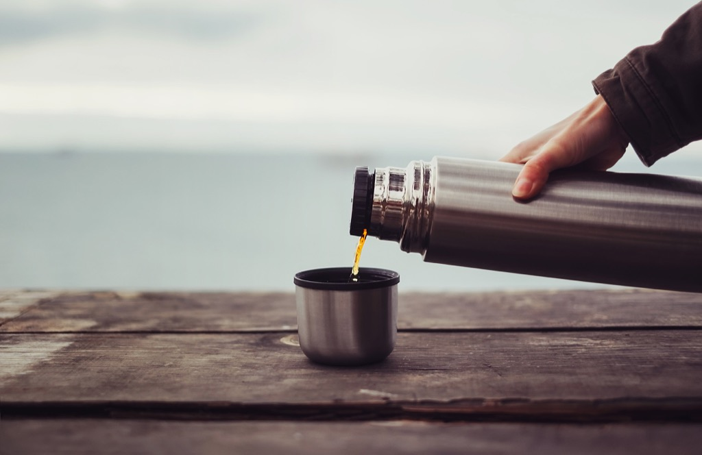 woman pouring coffee from thermos