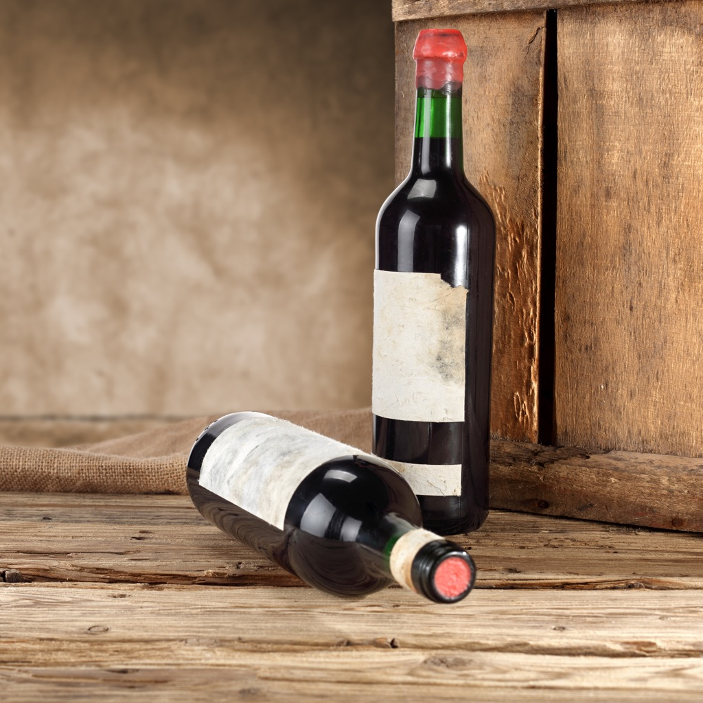 A pair of newer wine bottles.