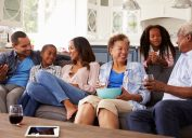 family having snacks on the couch, downsize your home