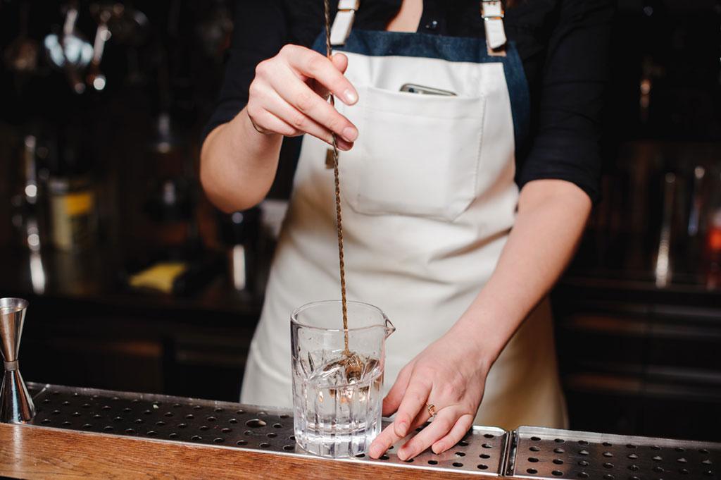 bartender stirring martini
