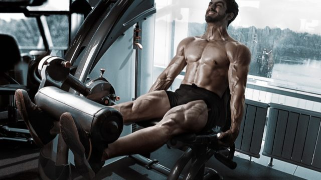 Man feeling the burn and swearing at gym