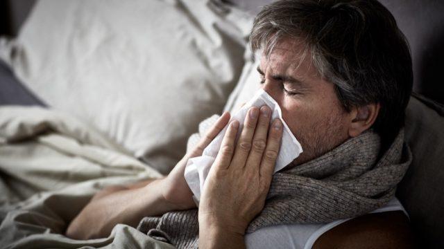 Man sick with man flu