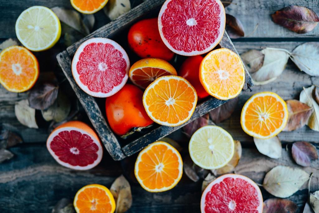 Citrus fruit, cut half ways, including grapefruit, orange, and limes