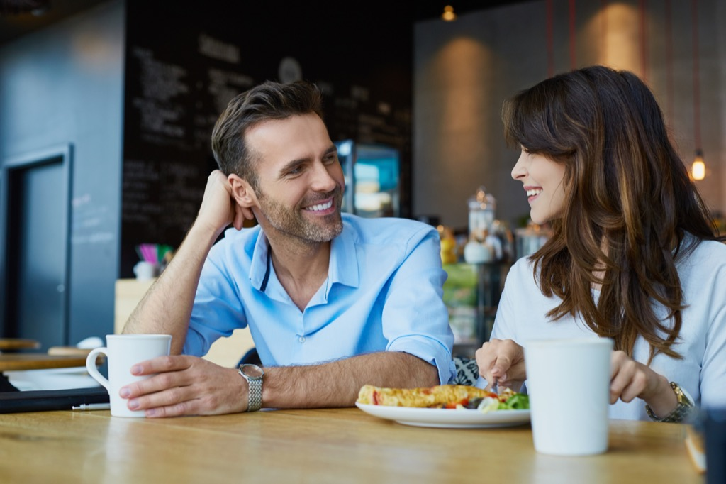 Beautiful couple eating together, open marriage
