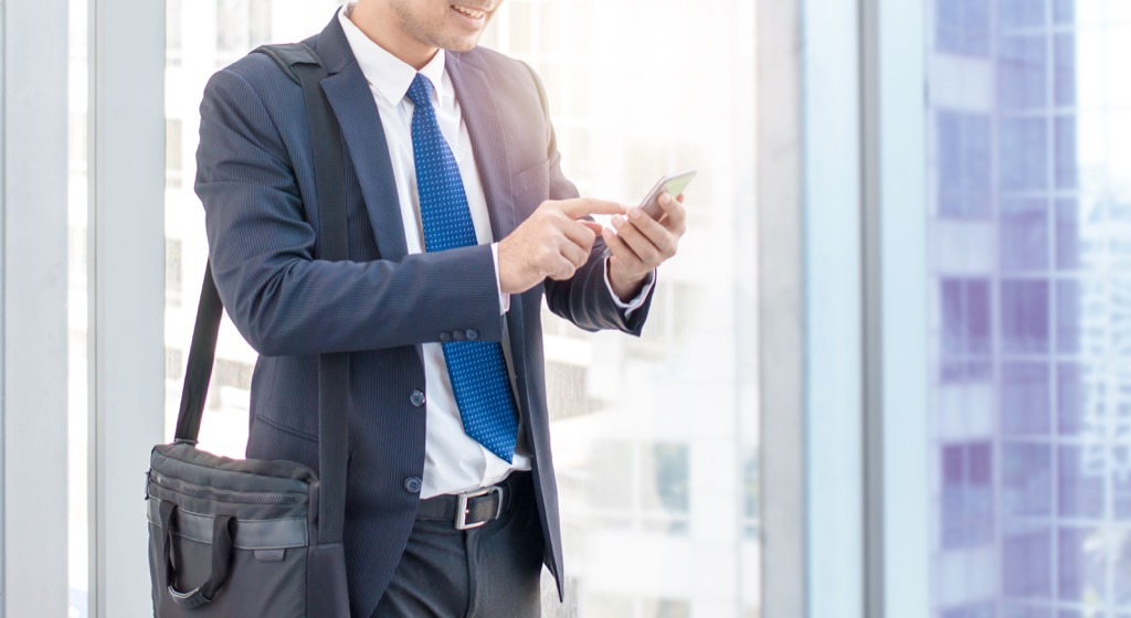 Businessman checking his smartphone