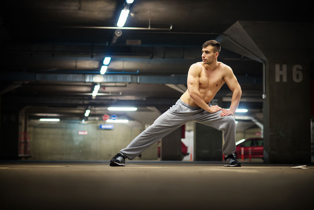 Man performing a lunge Exercises for Adding Muscle