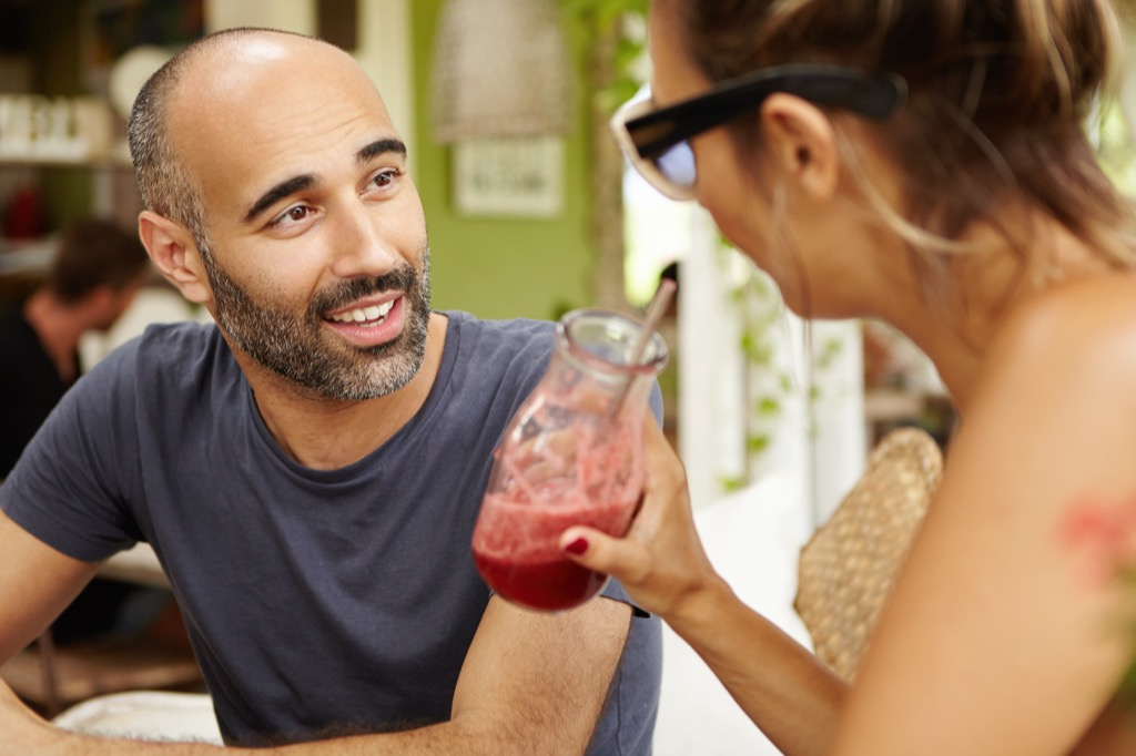 man and woman talking with smoothies, open marriage