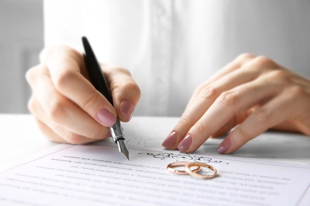 Woman signing a marriage contract, open marriage