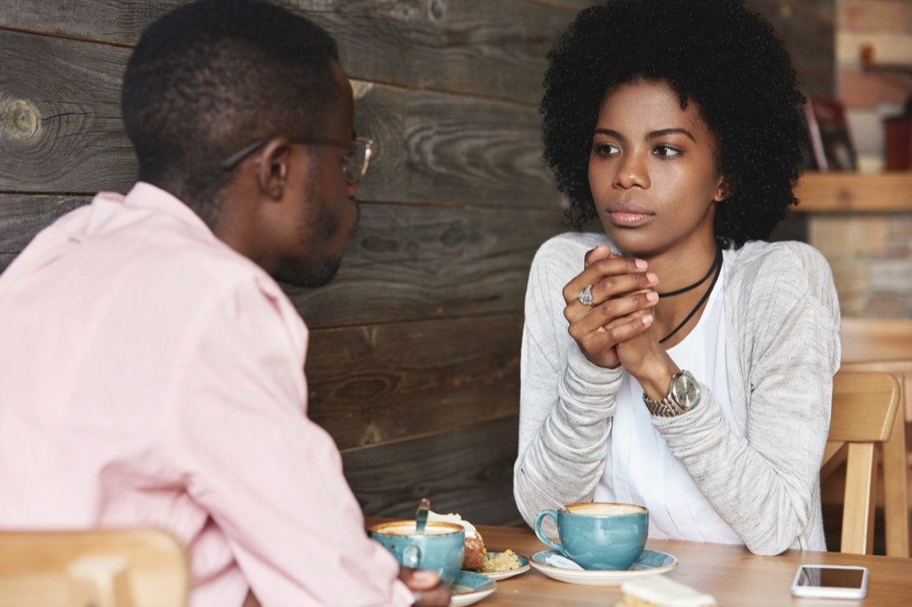 Young couple talking over coffees, open marriage