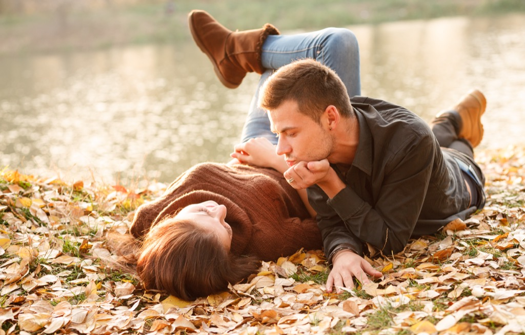 young couple sitting in the leaves, open marriage
