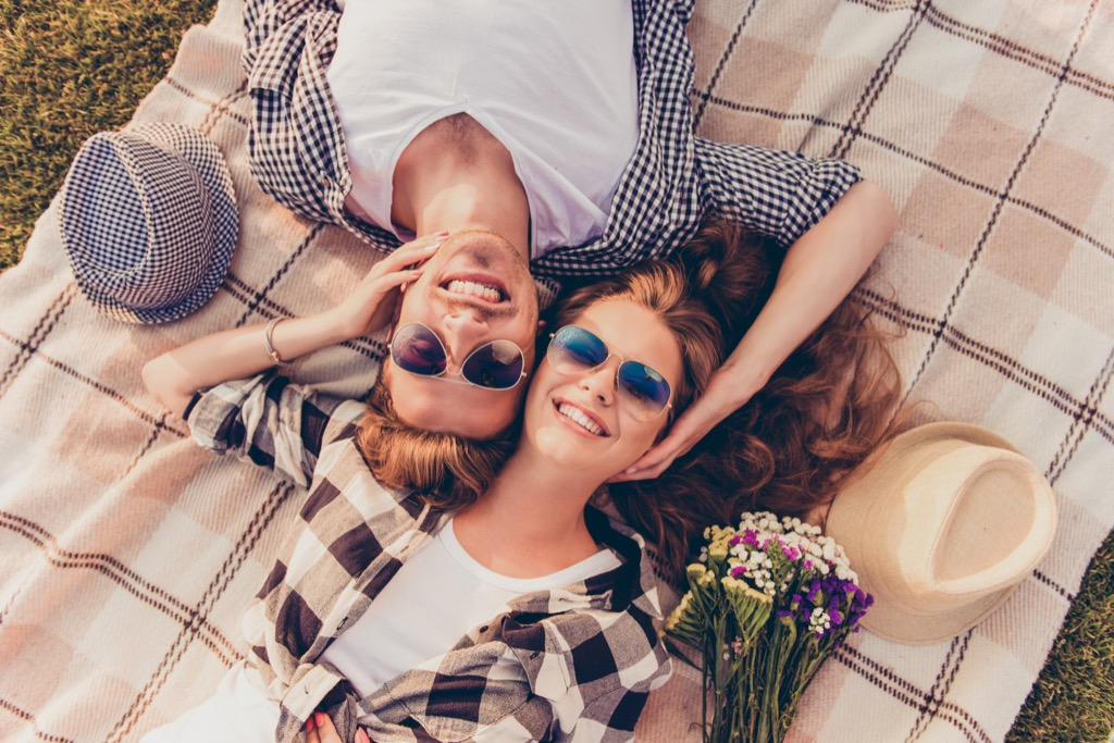 Young Couple sitting on a Picnic Blanket, open marriage