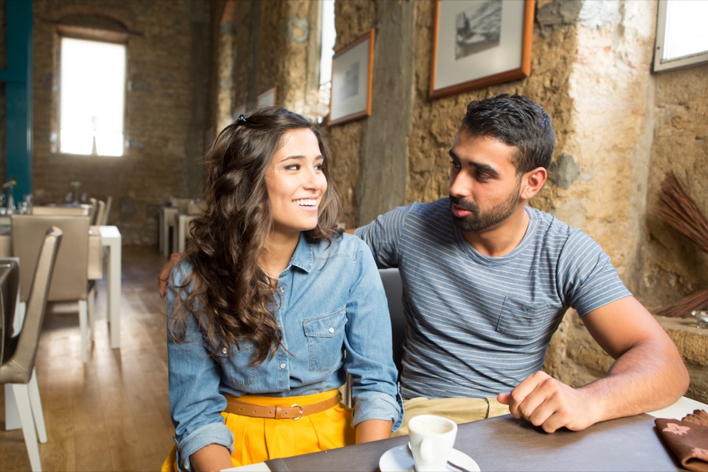 young couple sitting at a restaurant, open marriage