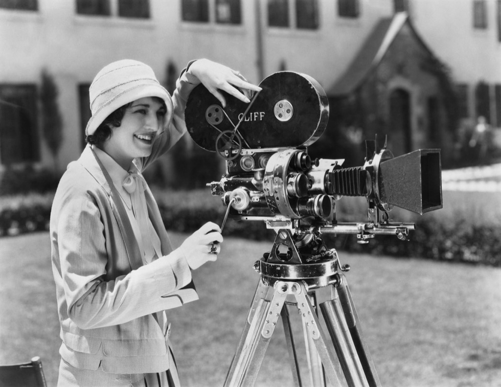 woman film camera