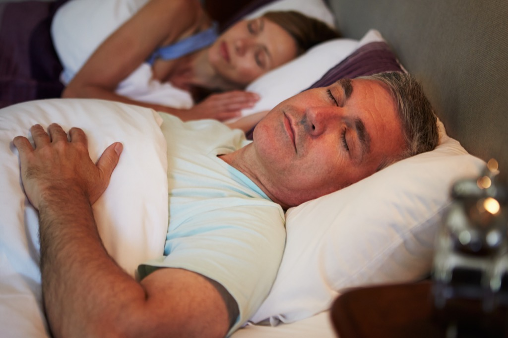Middle-aged couple sleeping