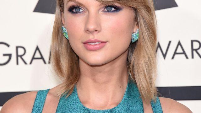 Taylor Swift in a blue dress