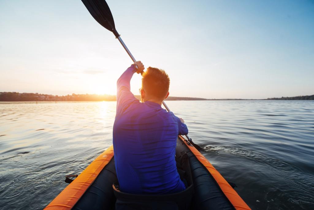 man kayaking in a lake, weight loss motivation