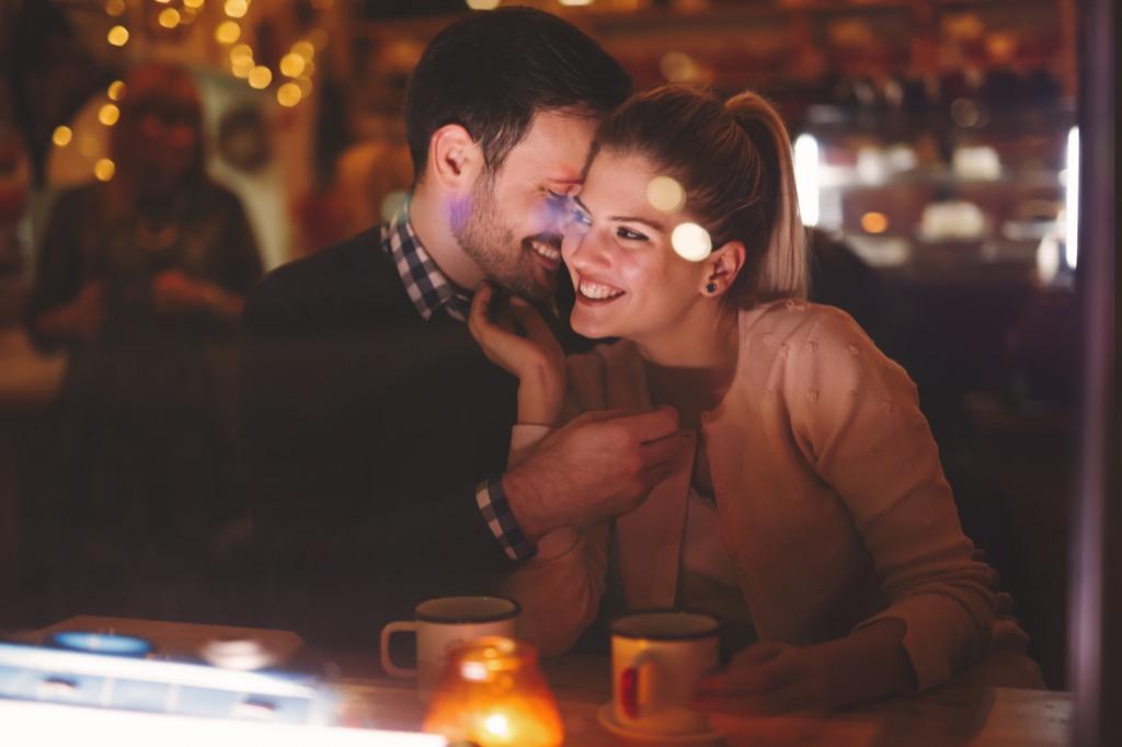 Couple Flirting in Restaurant
