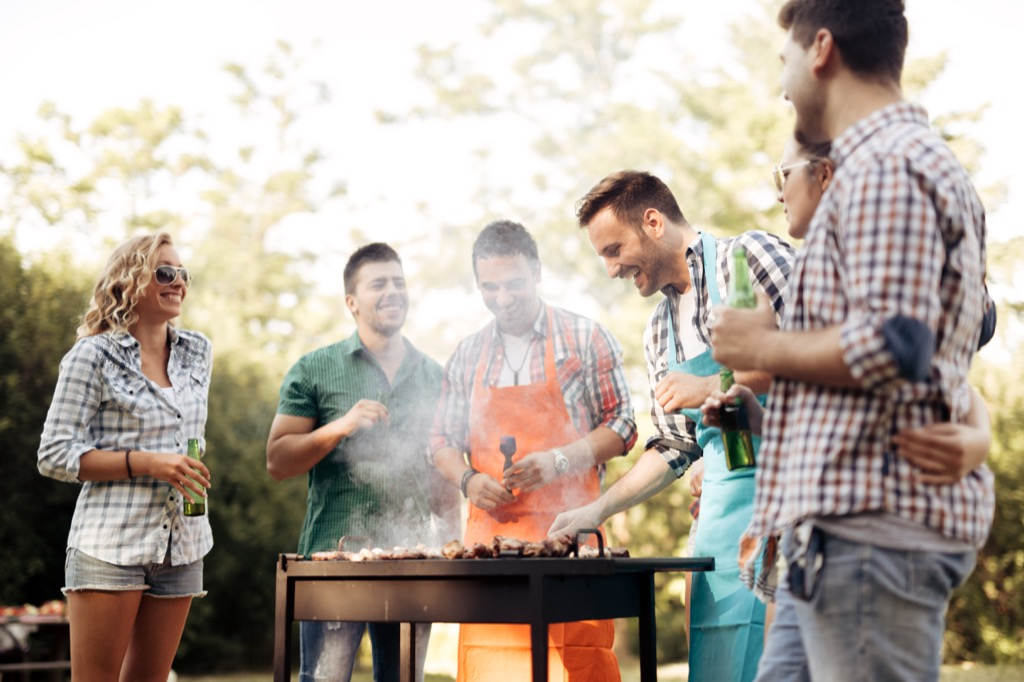group of people grilling BBQ together, how to make friends after 40