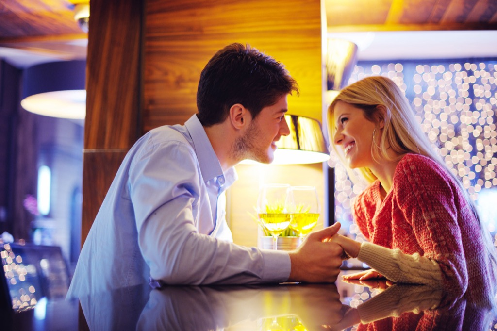 Couple flirting at restaurant from across the table