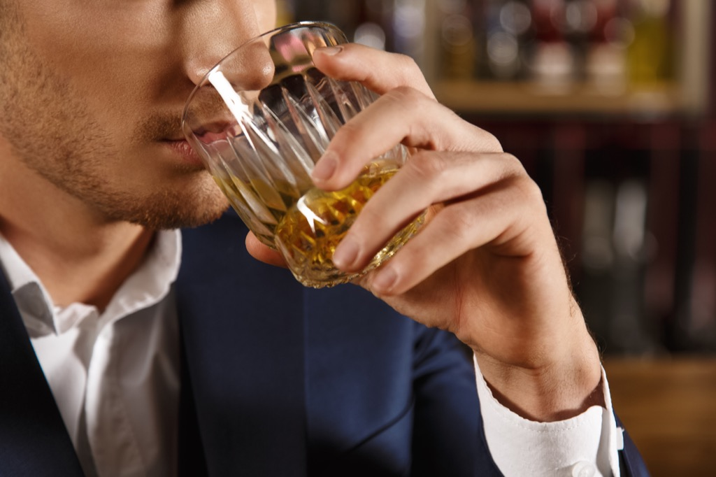 Man drinking whiskey, representing someone in the wrong job.