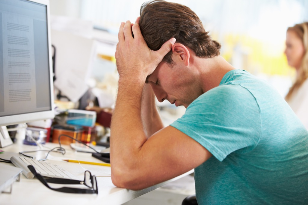 Man Stressed at Work, smart word, Everyday Energy Killers