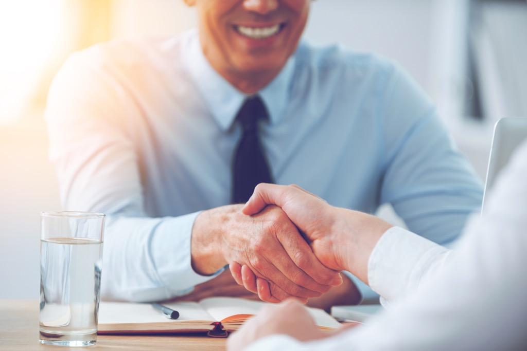 Two colleagues shaking hands college professor secrets