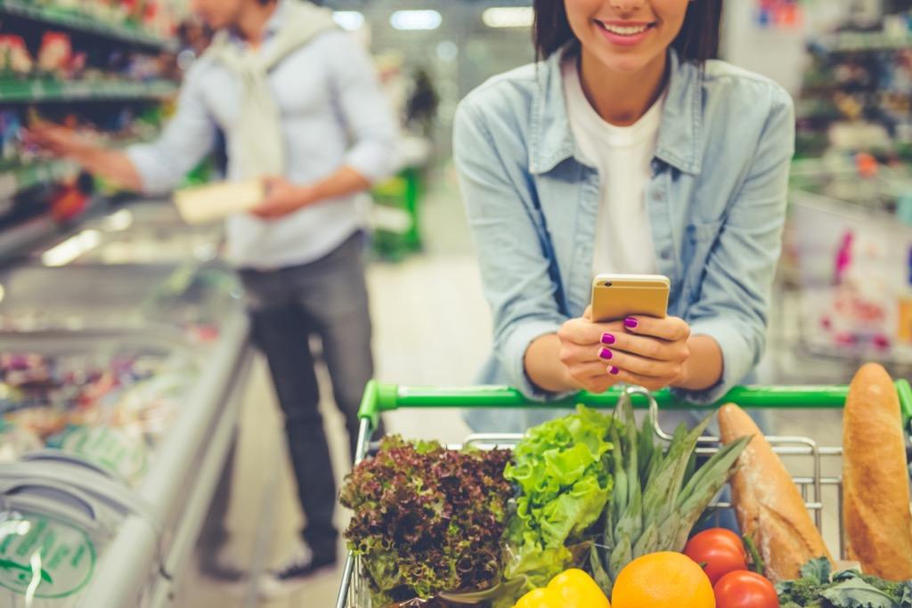 Woman Comparing Prices Walmart Secrets