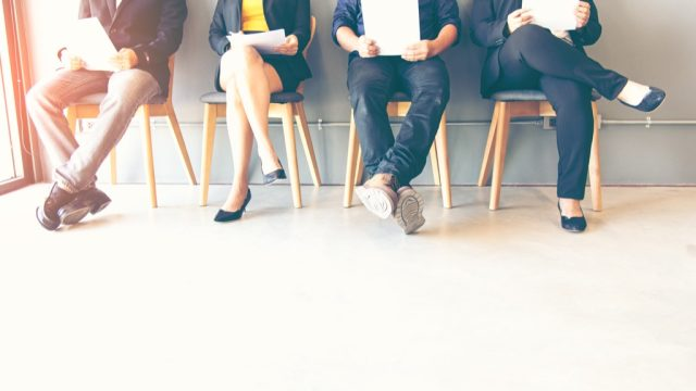 Candidates waiting for a job interview, studying interview questions, hiring