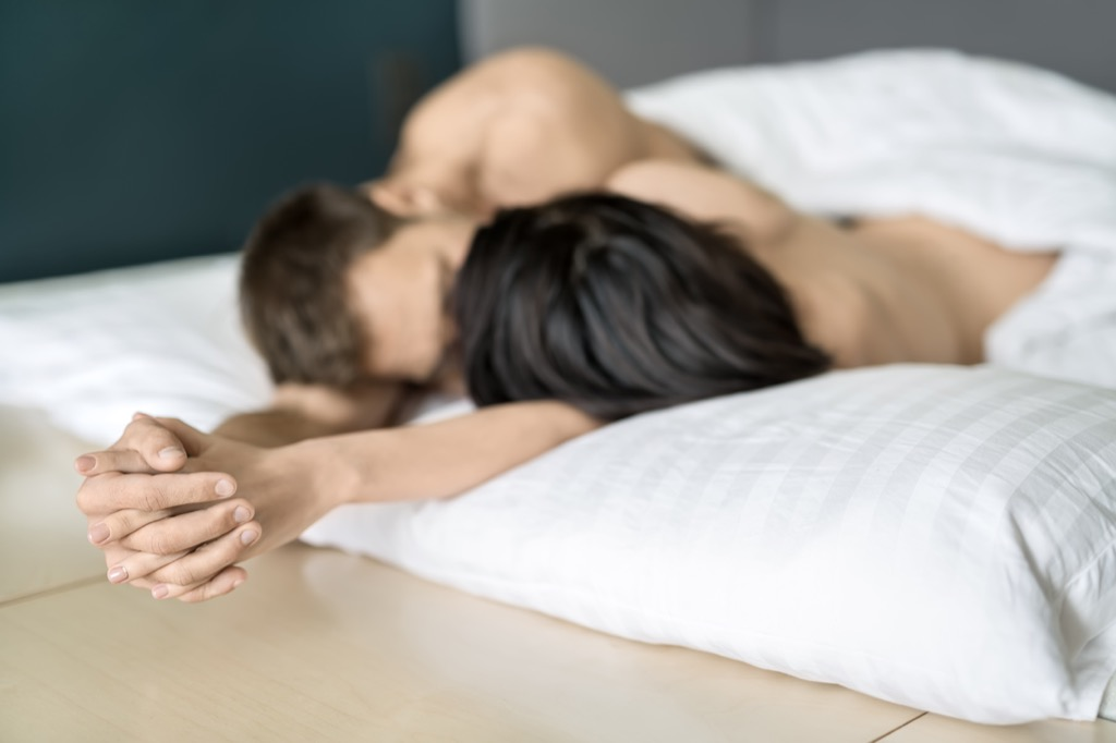 couple holding hands in bed, ways your body changes after 40