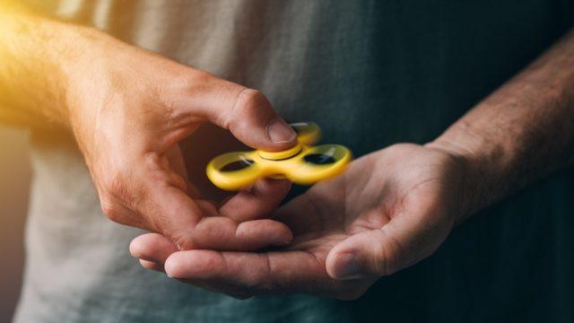man holding fidget spinner