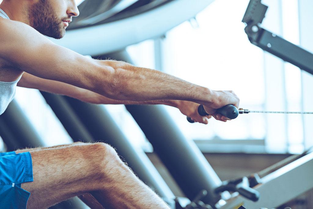 Guy on a rowing cardio machine