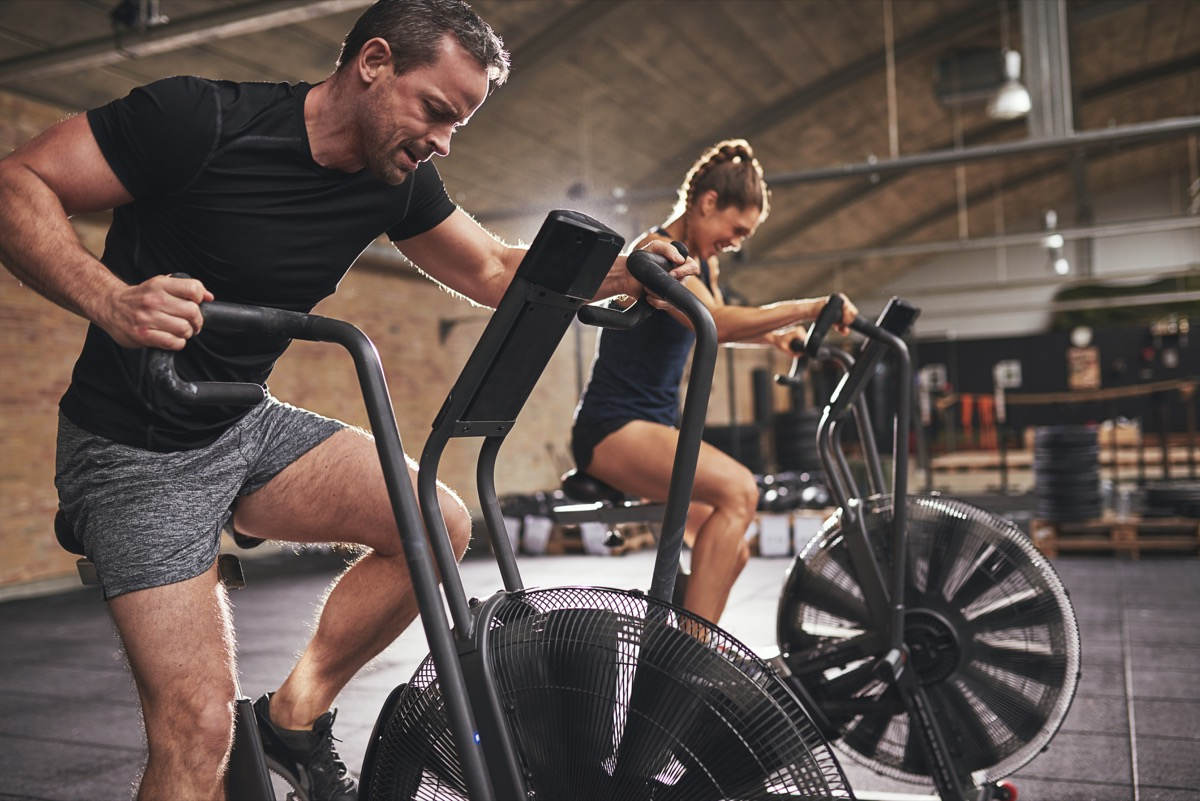 man and woman exercising cardio workouts for men over 40