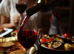 red wine being poured into glass, reduce alzheimers risk