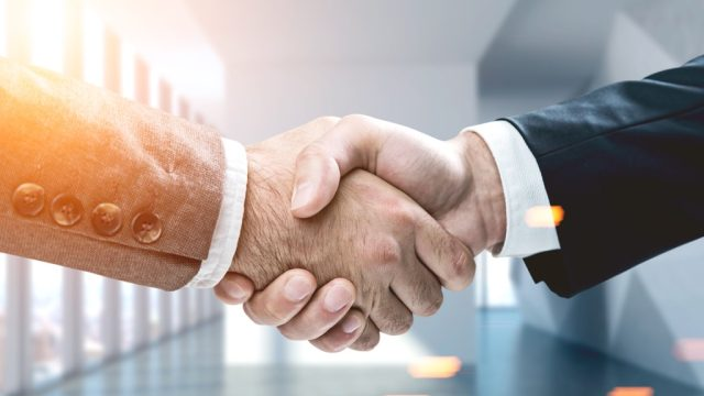Shaking hands, which represents the dreaded raise question.