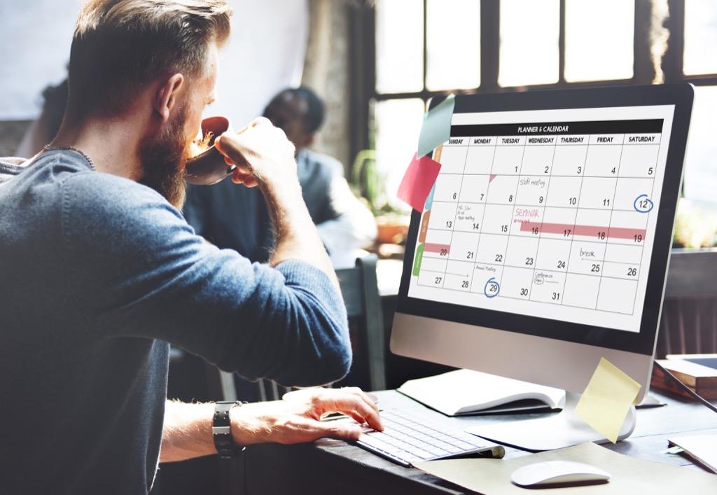 Man Looking at Calendar Regrets