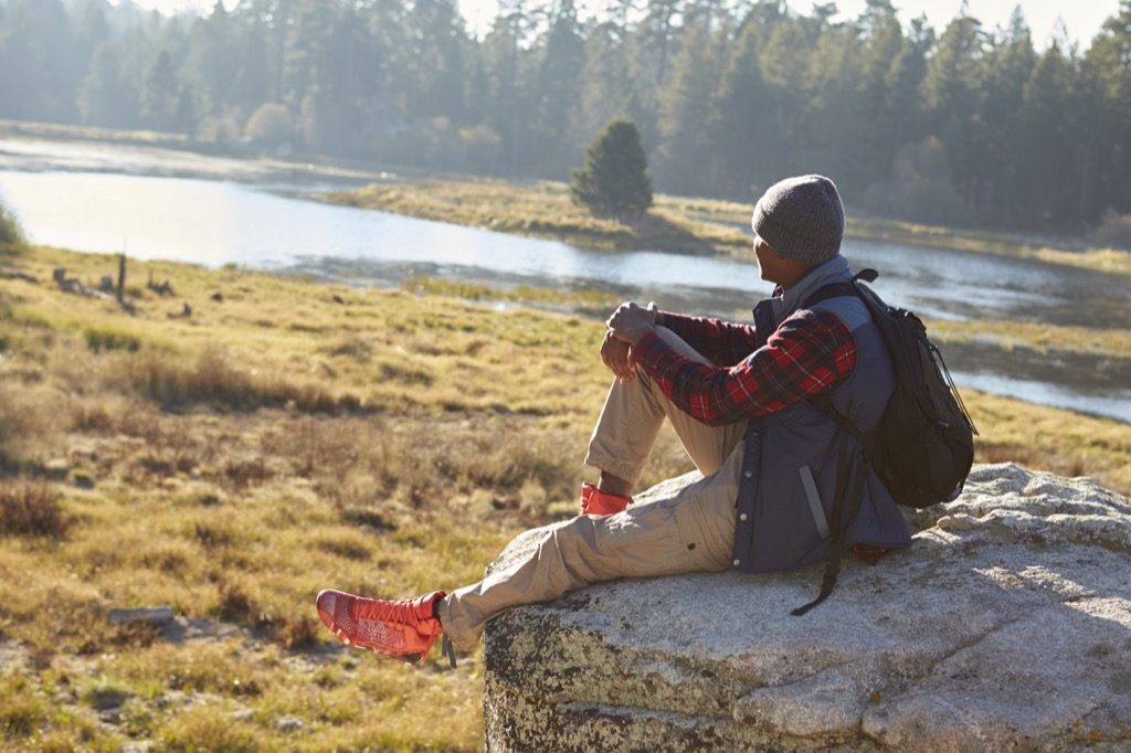 Man outside in nature, one of the surefire stress busters.
