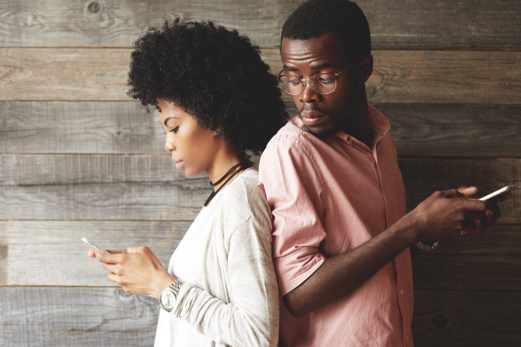 man looking at a woman's text messages
