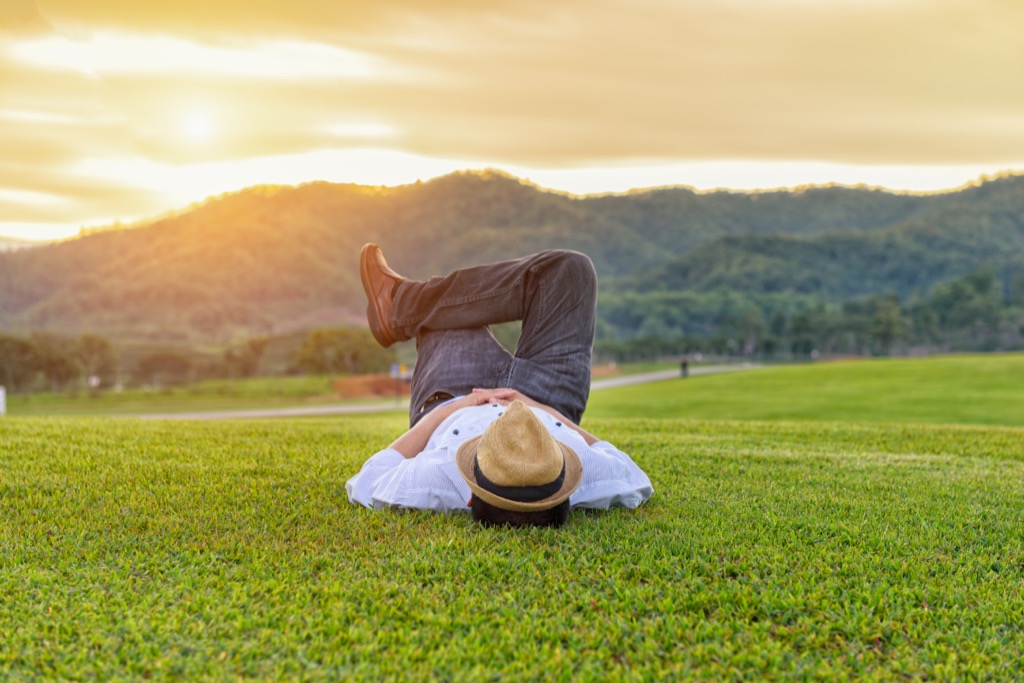 man laying on a lawn