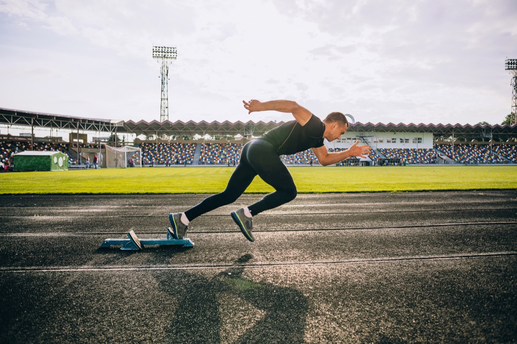 superhuman feats sprinting a mile on a track man and woman exercising cardio workouts for men over 40